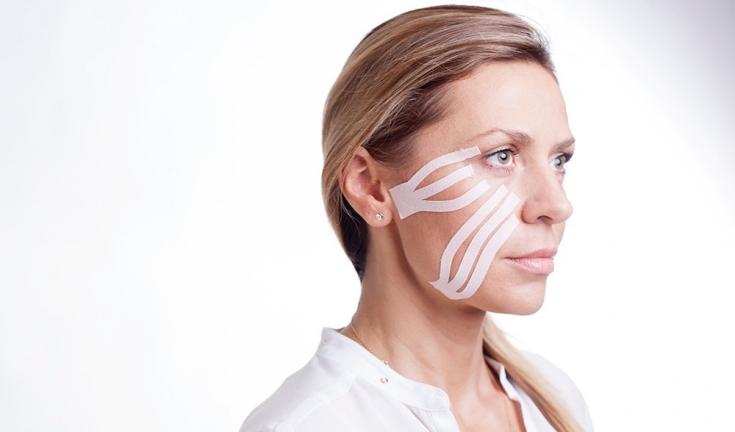 Косметическое тейпирование лица: омоложение с помощью кинезиотейпов